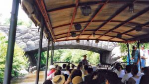 "Onboard a riverboat at the Safari Dock. Ahead beyond the bridge lies ""a few surprises""."